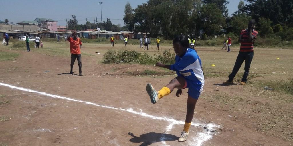 A Kasagm Lady taking a corner kick