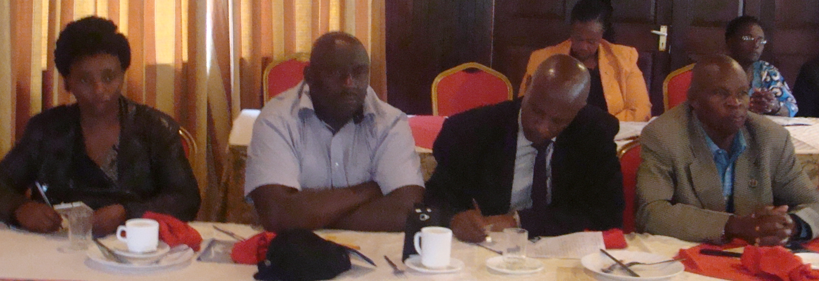 Members keenly following the discussion as they take a cup of tea